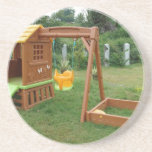 A child's playing equipment in a green location beverage coasters
