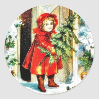 A christmas greeting with a baby holding christmas classic round sticker