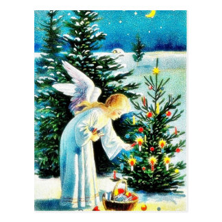 A christmas greeting with an angel sets fire on a postcard