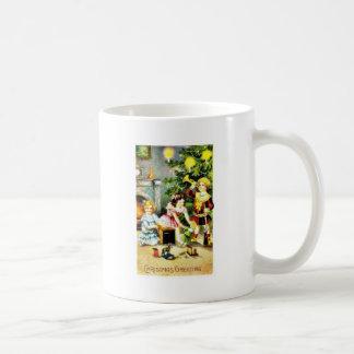 A christmas greeting with kids playing infront of coffee mug