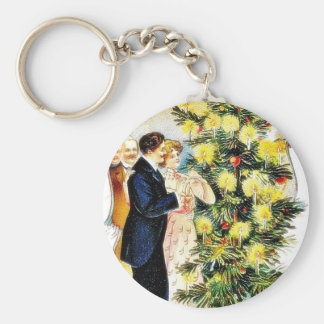 A christmas greeting with people decorating the ch keychain