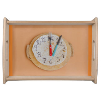 a clock made of piadina on large tray