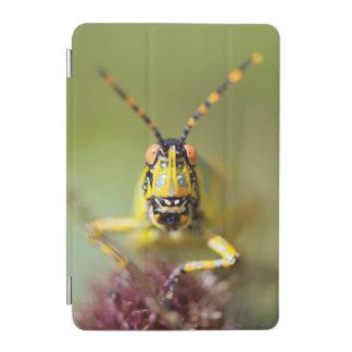 A close-up of an Elegant Grasshopper iPad Mini Cover