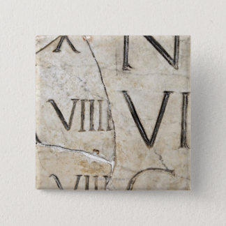 A close-up of ancient Roman letters on marble. 15 Cm Square Badge