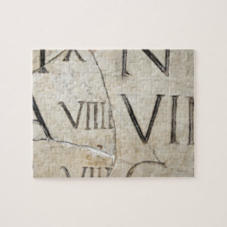 A close-up of ancient Roman letters on marble. Jigsaw Puzzle