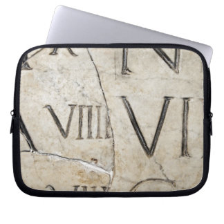 A close-up of ancient Roman letters on marble. Laptop Sleeve