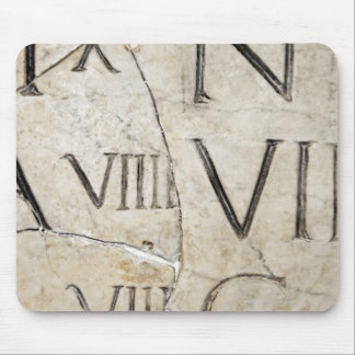 A close-up of ancient Roman letters on marble. Mouse Pad