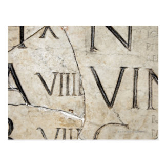 A close-up of ancient Roman letters on marble. Postcard