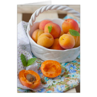 A closeup of apricots in a bowl card