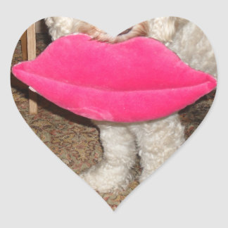 A cockapoo dog holding one of his toys perfectly! heart sticker