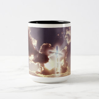 A coffee mug with a cross in the sky