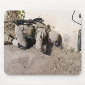 A combat engineer searches for weapons caches mouse mat