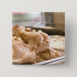 A container full of hazelnut ice cream 15 cm square badge