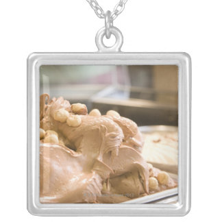 A container full of hazelnut ice cream silver plated necklace