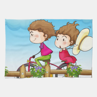 A couple riding a bicycle tea towel