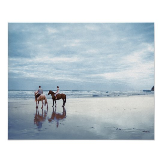 A couple riding horses on Parkiri beach in