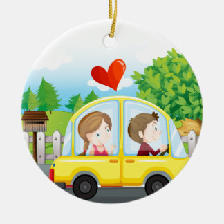 A couple riding on a yellow car christmas ornament