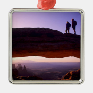 A couple watches sunrise from atop Mesa Arch in Silver-Colored Square Decoration