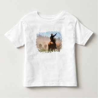 A cowboy out working the herd on a cattle toddler T-Shirt