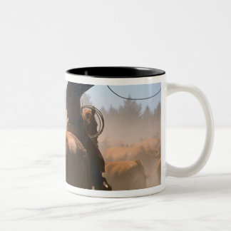 A cowboy out working the herd on a cattle Two-Tone coffee mug