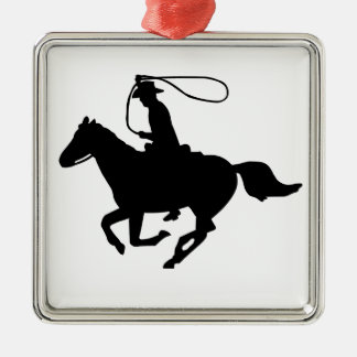 A cowboy riding with a lasso. christmas ornament