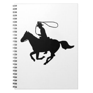 A cowboy riding with a lasso. notebook