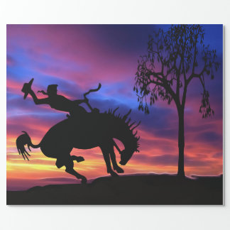 A cowboy silhouette at sunset wrapping paper