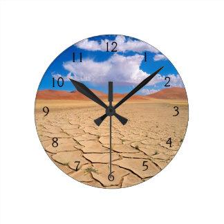 A cracked desert plain round clock