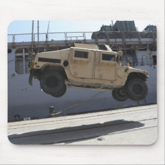 A crane lifts an M998 Humvee Mouse Pad