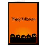 A Creepy Row of Halloween Pumpkins Greeting Card