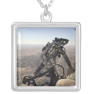A crew chief looks for suspicious activity silver plated necklace