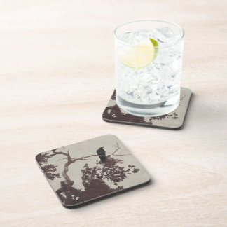 A Crow on a Branch in a Tree with Burgundy Leaves Drink Coasters