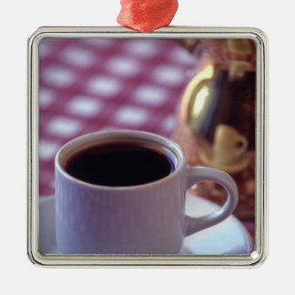 A cup of Arabic Coffee. Syria. The Middle Silver-Colored Square Decoration