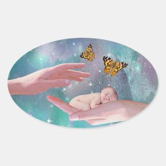 A cute baby boy in hand fantasy oval sticker