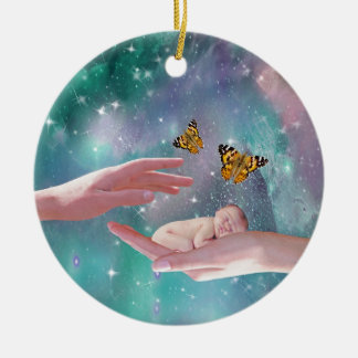 A cute baby in hand fantasy christmas ornament