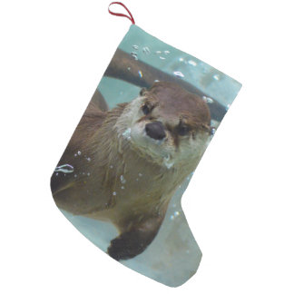 A cute Brown otter swimming in a clear blue pool Small Christmas Stocking