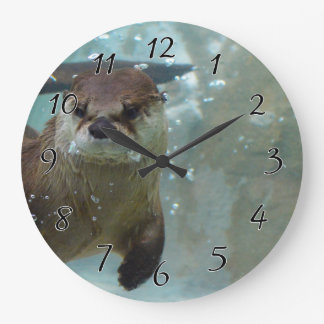 A cute Brown otter swimming in a clear blue pool Wallclock