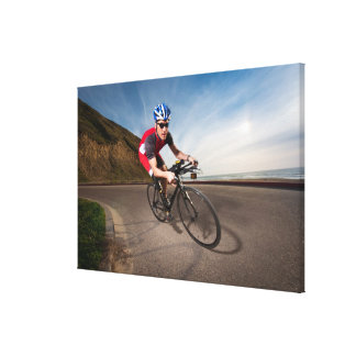 A cyclist leaning into a corner canvas print