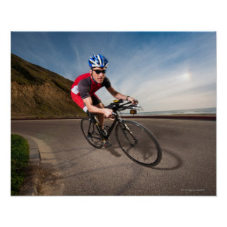 A cyclist leaning into a corner poster
