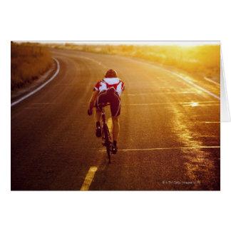 A cyclist on road bike near Great Salt Lake Greeting Card
