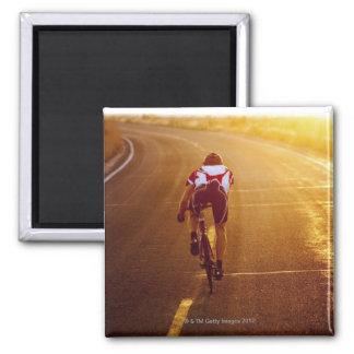 A cyclist on road bike near Great Salt Lake Square Magnet