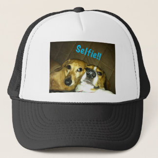 A dachshund and a beagle taking a selfie trucker hat