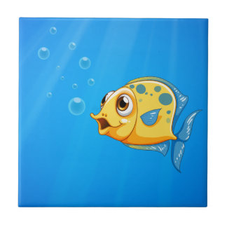 A deep ocean with a yellow fish small square tile