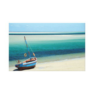 A Dhow at the waters' edge in Mozambique Canvas Print