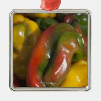 a display of colourful peppers for sale at the Silver-Colored square decoration