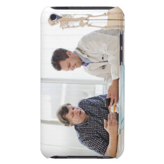 A doctor meeting with a patient and talking and barely there iPod cover