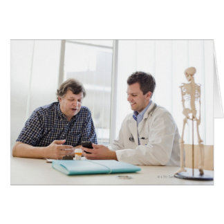 A doctor meeting with a patient and talking and card