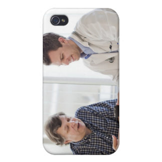 A doctor meeting with a patient and talking and case for the iPhone 4