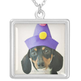 A dog wearing a funny hat square pendant necklace