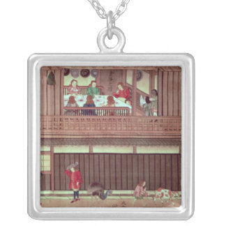 A domestic scene   of a scroll) silver plated necklace